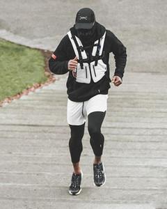 Homens Verão Trainning Exercício Shorts Calça de ginástica do esporte magros Jogging Corredores Sweat Falso respirável duas peças Pants Calças