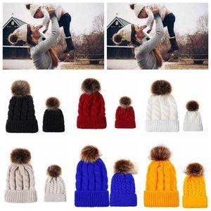 Родитель-ребенок Pom Pom Beanie 9 цветов зима теплая имитация меха енота вязаные шапки открытый Beanie OOA7094