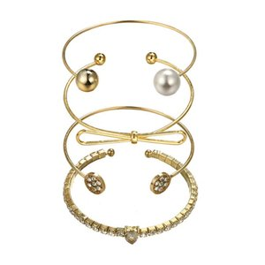 Regolabile in oro 4 pezzi Set Bow Diamante Pearl Ball Open Bangle Bracciali Wristband Accessori gioielli donna Bracciale Set