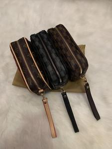 las mujeres bolsa de aseo viajes hombres de la moda 2020 nuevo diseñador de alta calidad Organizador cosmético compone el bolso famoso artículo de tocador de la marca clásica