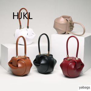 Leather women's bag European and American vogue retro lady's hand-held jingling dumpling cloud swallow woman's bag