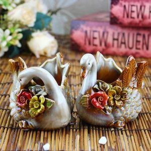 de nouveaux métiers en céramique chinois bureau d'ameublement maison nouveauté créative ornement foever fleur vase cygne èconomiseur boîtes un couple