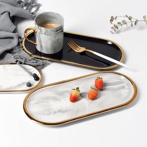 طلاء الذهب الرخام السيراميك التخزين صينية أسود أبيض أوروبا الأغذية الفاكهة الإفطار البيضاوي لوحة مجوهرات علبة الحلوى الديكور صحن