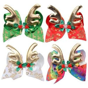 Horquilla para el cabello Navidad de 6.7 pulgadas Arco para el cabello Cornamenta dorada con diamantes Impresión en la nieve Hoja Desig Bow Accesorios para el cabello EEA373