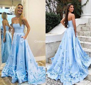 Chic sin tirantes Sky Blue Prom Dresses 2019 Butterfly Appliques vestidos de fiesta de graduación con bolsillos Satin Prom vestido de noche