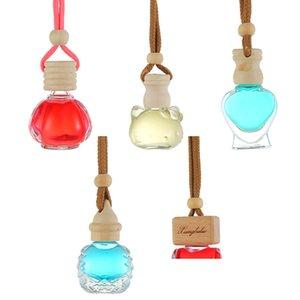 Botella de cristal de perfume del gato en forma de corazón vacío botellas transparentes de coches Colgando ambientador de aire pendiente del ornamento vacío envase cosmético GGA2891