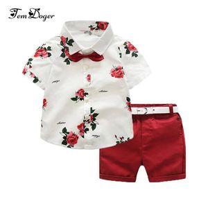 Tem Doger летние мальчики одежда устанавливает Детская одежда набор дети мальчик одежда цветок галстук рубашки + шорты 2 шт. джентльмен костюм с галстуком