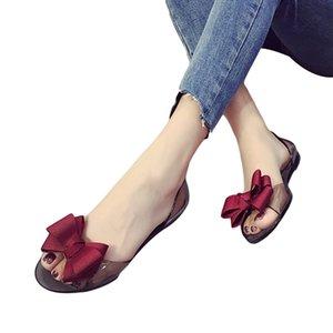 2020 صيف جديد Favolook المرأة القوس زهرة جيلي شاطئ الصنادل عارضة الوجه يتخبط أحذية مسطحة أحذية الصنادل الأزياء واضح أحمر أسود