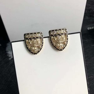 Fashionable pearl shield letter stud