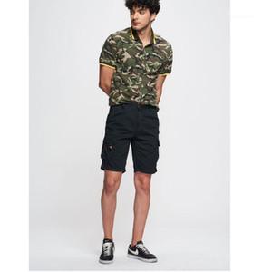 Moda relajado ropa Casual para hombre verano Color sólido Cargo pantalones sueltos cremallera botón bolsillo Homme Shorts