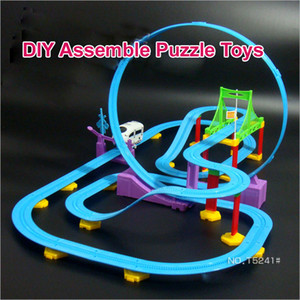 Free shipping Professional Kid Puzzle Toys Educational Soft Musical Plastic Assembly DIY Flexible Railway Train Toys For Boy