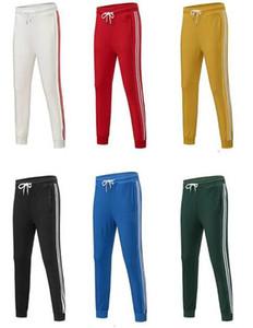 2020 Mens de la manera Joggers 6 colores nuevo deporte pantalón rayas Panalled Lápiz Pantalones del basculador Envío libre más el tamaño S-4XL opcional