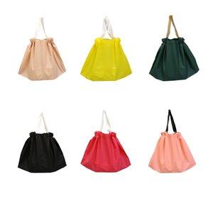 50Pcs lot Large Plastic Packaging Bag 12 Colors Garment Gift Bag with Handles EVA Clothing Shopping Bag Custom Logo
