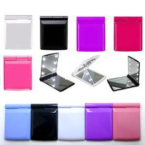 Maquiagem Espelho com 8 luzes LED Lâmpadas Cosmetic Folding portátil compacto de bolso Espelho de Mão Make Up sob luzes de navegação livre