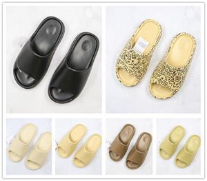 카니 예 웨스트 (Kanye West) 슬라이드 지구 브라운 수지 뼈 블랙 남성 여성 비치 샌들 거품 편안 디자이너 스포츠 트레이너 신발을 실행