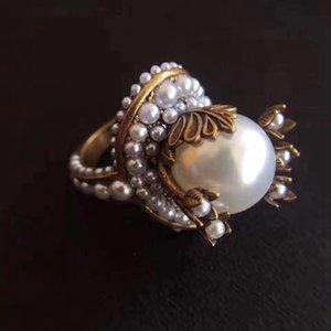 AprilGrass Marken-Designer-Verkäufe Messing Große Bling Perle verlässt Finger-Ring-GU Jahrgang Blumenblatt-Blumen-Finger-Ring-Partei-Hochzeit kühle Schmucksachen