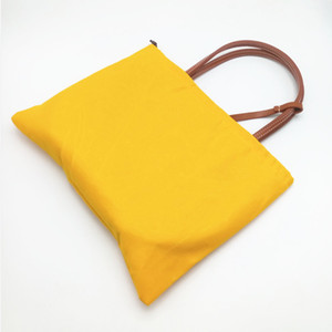 Mode féminine Sac Petit Sacs de plage avec garniture en cuir véritable et poignée Mini réversible Totes avec sac à poussière