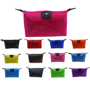 Bolso de maquillaje Dumpling Color sólido Bolsa de cosméticos portátil Bolsa de almacenamiento creativa Organizador de lavado de viaje Bolso de maquillaje HHA530