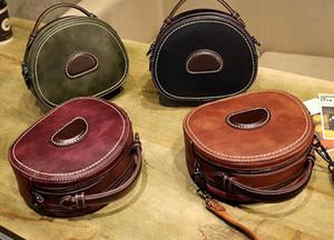 Diseñador-La nueva moda de Corea versión de Baitao pequeña bolsa de un solo hombro redonda con bolso oblicuo, y el bolso de cuero en 2020
