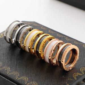 Titan Stahl Großhandel keramischer Ring Priced Stern Big Love Titan-Stahl-Ausführung des Kreisbogenrand Schwarzweiss-Keramik-Rings