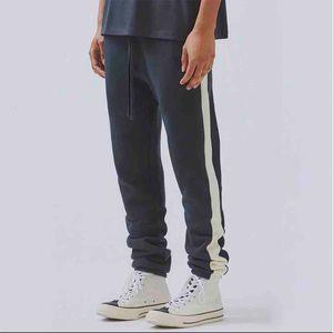 FOG Essentials Sweatpants Fear Of God Side Splice calças de suor Homens Mulheres Casual Longo Jogger Pants Hip Hop Skate Streetwear
