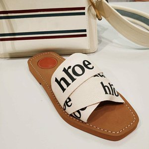 Summer New Brand Woman Fashion Peep Toe Outdoor Flat Slippers Female Letters Elastic Slippers Popular Cross Cloth Holidays Casual Slippers