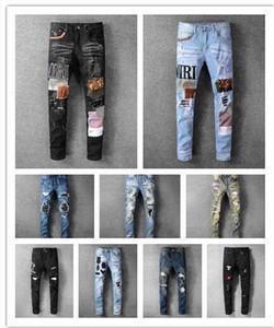 Nova maré alta qualidade esticar buraco elásticos pés magros calças bordadas homens marca colagem moda jeans calças