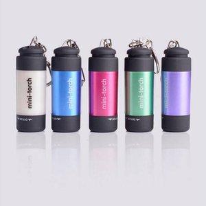 LED مصباح يدوي سلسلة المفاتيح هاندي LED ضوء المصباح التخييم المحمولة البلاستيك البسيطة الجيب حلقة مفاتيح مصباح الأنوار للماء اكسسوارات DYP409