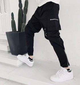 Automne Hiver Haute Qualité France Europe Refroidir Nylon Noir Pantalons Hommes Femmes Hip Hop Appliqué marque pantalon cargo de Split Zipper