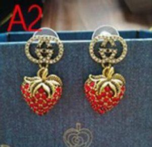 Perno rotondo classico dell'orecchino dell'oro dell'orecchino del progettista della lettera di Vogue per i gioielli della signora della ragazza delle donne Trasporto libero