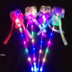 Los niños de iluminación LED varita mágica Hada Sticks forma de arco de mano se escuchó alrededor de la estrella del banquete de boda del concierto de la decoración de San Valentín regalo HHA935