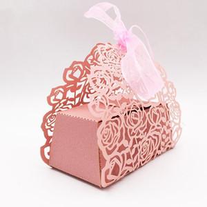 10pcs / set Rosa a forma di fiore tagliato al laser Hollow Carriage favorisce i regali di caramella con il nastro del bambino matrimonio doccia feste