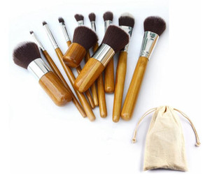 Juego de pinceles de maquillaje con mango de bambú con bolsa Kit de pinceles de cosméticos profesionales Kit de pinceles de sombra de ojos de maquillaje Herramientas de maquillaje 11pcs / set