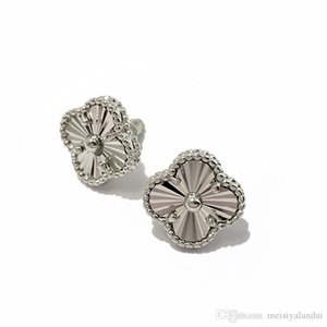 Exquisite copper plated glossy four-leaf designer jewelry women earrings clover car flower carved earrings stud earrings