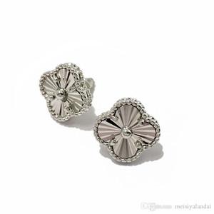 cuivre exquis plaqué fleurs brillantes boucles d'oreilles voiture trèfle femmes bijoux design à quatre feuilles boucles d'oreilles sculptées boucles d'oreilles