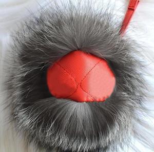 Designer-Frauen-Handtaschen Parts Mode Taschen Accessoires Anhänger Zwei Augen Gesicht Kleines Monster Tasche Auto Schmuck Anhänger