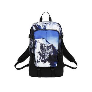 Mâle et femelle Snow Mountain Pattern Backpack Voyage en plein air résistant à l'usure imperméable sac d'étudiant Loisirs sac nouveau style gros