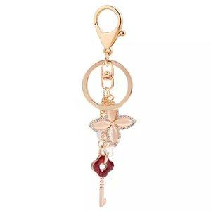 Quatro Folhas Moda Mulheres do Trevo e Design Chaves do metal Alloy Rose banhado a ouro Keychain Chaveiro Car Presente de Natal Chaveiros
