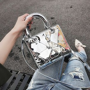 Silver Laser Type Metallic Handbag Casual Tote Bag For Any Causal Use.