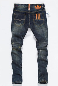 جديد مصمم رجالي جينز نحيل السراويل عارضة الجينز الفاخرة الرجال الأزياء المتعثرة ممزق سليم للدراجات النارية موتو السائق الدينيم الهيب هوب السراويل