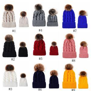 El otoño y el invierno bola de sombrero de punto de giro imitación padre-hijo femenina trenza de pelo bola gorro de lana caliente EEA559