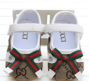 Nueva niña zapatos de la princesa Bowknot lindo Kid antideslizante en los zapatos del niño de 0-18 meses de cuna Hook Loop primeros caminante