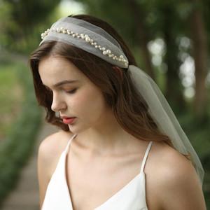 Boda de estilo europeo velos de tul suave con las perlas nueva llegada Velos de novia Accesorios de boda Luz Champagne
