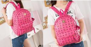 2021 mulheres elegantes MOM Rebites Mochila Schoolbag Cor Bolsa Casual Shoulder Menina do estudante Bolsa Satchel Bag Campo Viagem Mochila