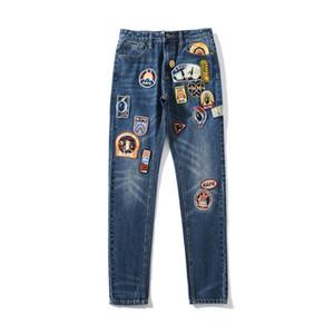 Bape нового способа Мужские Проблемные ZippeR Джинсы мужские стилиста Badge Вышитые Брюки Мужчины стилиста Hip Hop Джинсовые брюки