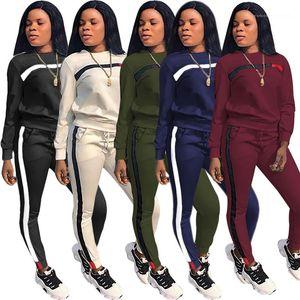 Полосатый печатных 2 шт. спортивные наборы мода свободные дамы две части костюмы лоскутное печатных женские спортивные костюмы осень с длинным рукавом круглый вырез