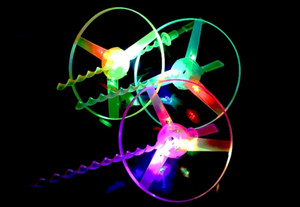Hot LED flashing Light up Hot Sale Plastic Outdoor Children's Flashing light up Hand Push Rotary Flying Saucer Toys For Kids