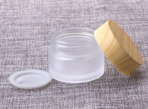 15g di vetro trasparente smerigliato vaso di vetro opaco cosmetico crema per il viso contenitore di cera deposito di scorta 15 ML con coperchio in plastica di grano di legno OEM personalizzato