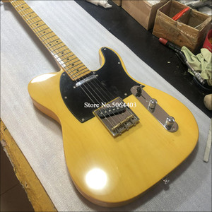 High quality electric guitar. Pale yellow paint, copper string column, round socket, free delivery