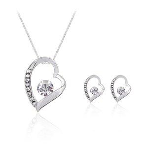 Crystal Heart Love Necklace Earings Conjuntos de Joyas Hollow Heart Studs para Mujeres Novia Dama de honor Joyería de La Boda ENVÍO
